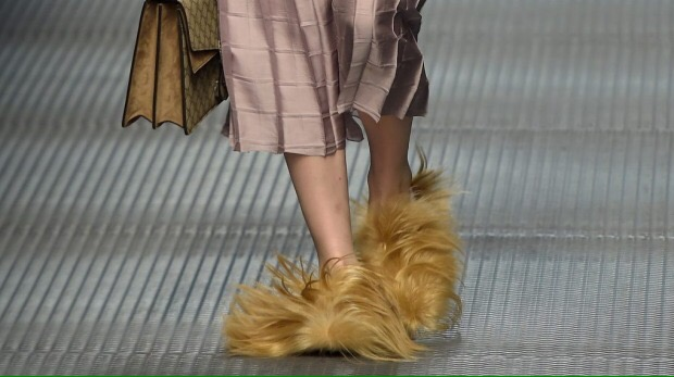 http://www.fashionofgoodwill.org/blog/great-for-slippers-not-for-the-streets-furry-shoes/ is where picture is from